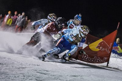Athletes compete during the first stop of the Riders Cup, the season opener of the Ice Cross Downhill World Championship in Wagrain, Austria on December 10, 2016.