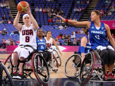 BASKET FAUTEUIL - JEUX PARALYMPIQUES - 2012 Aug 30, 2012; London, United Kingdom; USA player Desi Miller (8) shoots under pressure from France player Blandine Belz (12) during the London 2012 Paralympic Games at Basketball Arena. Mandatory Credit: Paul Cunningham-US PRESSWIRE