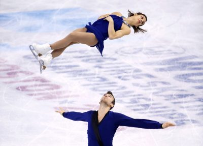 PATINAGE ARTISTIQUE - CHPT DU MONDE ISU - 2016 Apr 2, 2016; Boston, MA, USA; Megan Duhamel is thrown by her partner Eric Radford (CAN) during their gold medal performance in the pairs free skate competition at the ISU World Figure Skating Championships at TD Garden. Mandatory Credit: Winslow Townson-USA TODAY Sports