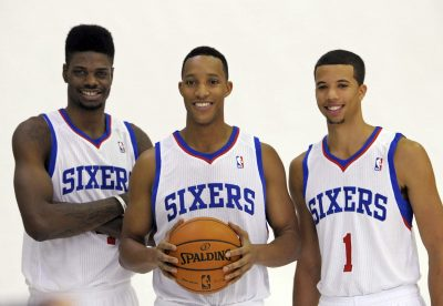 BASKET - NBA - 2013 Sep 27, 2013; Philadelphia, PA, USA;  Philadelphia 76ers center Nerlens Noel (4), small forward Evan Turner (12) and point guard Michael Carter-Williams (1) during a media day photo shoot at Philadelphia College of Osteopathic Medicine. Mandatory Credit: Eric Hartline-USA TODAY Sports *** Local Caption ***