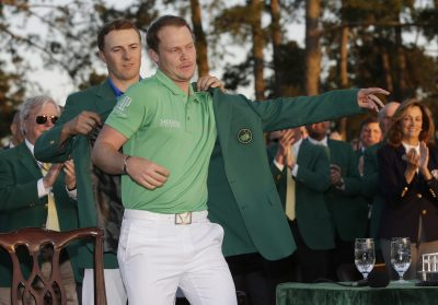 GOLF - PGA - MASTERS - 2016 Apr 10, 2016; Augusta, GA, USA; Danny Willett is helped into the green jacket by Jordan Spieth after Willett won the 2016 The Masters golf tournament at Augusta National Golf Club. Mandatory Credit: Rob Schumacher-USA TODAY Sports *** Local Caption ***