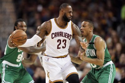 BASKET - NBA - 2017 May 23, 2017; Cleveland, OH, USA; Boston Celtics guard Avery Bradley (0) defends Cleveland Cavaliers forward LeBron James (23) during the first half in game four of the Eastern conference finals of the NBA Playoffs at Quicken Loans Arena. Mandatory Credit: Ken Blaze-USA TODAY Sports *** Local Caption ***