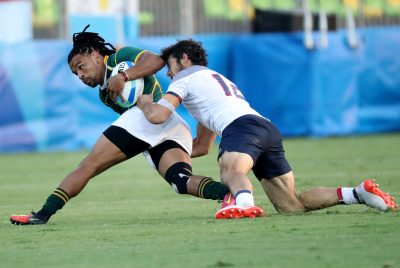 2016 - JO 2016 - RUGBY A 7 Aug 9, 2016; Rio de Janeiro, Brazil; South Africa back Rosko Specman (8) is tackled by France back Vincent Inigo (12) during a rugby sevens match between South Africa and France at Deodoro Stadium in the Rio 2016 Summer Olympic Games. Mandatory Credit: Geoff Burke-USA TODAY Sports