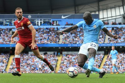FOOT - PREMIER LEAGUE - 2017 9th September 2017 - Premier League - Manchester City v Liverpool - Benjamin Mendy of Man City cross the ball beyond Jordan Henderson of Liverpool - Photo: Simon Stacpoole / Offside. EDITORIAL USE ONLY - any other use requires an additional license from Football DataCo - www.football-dataco.com
